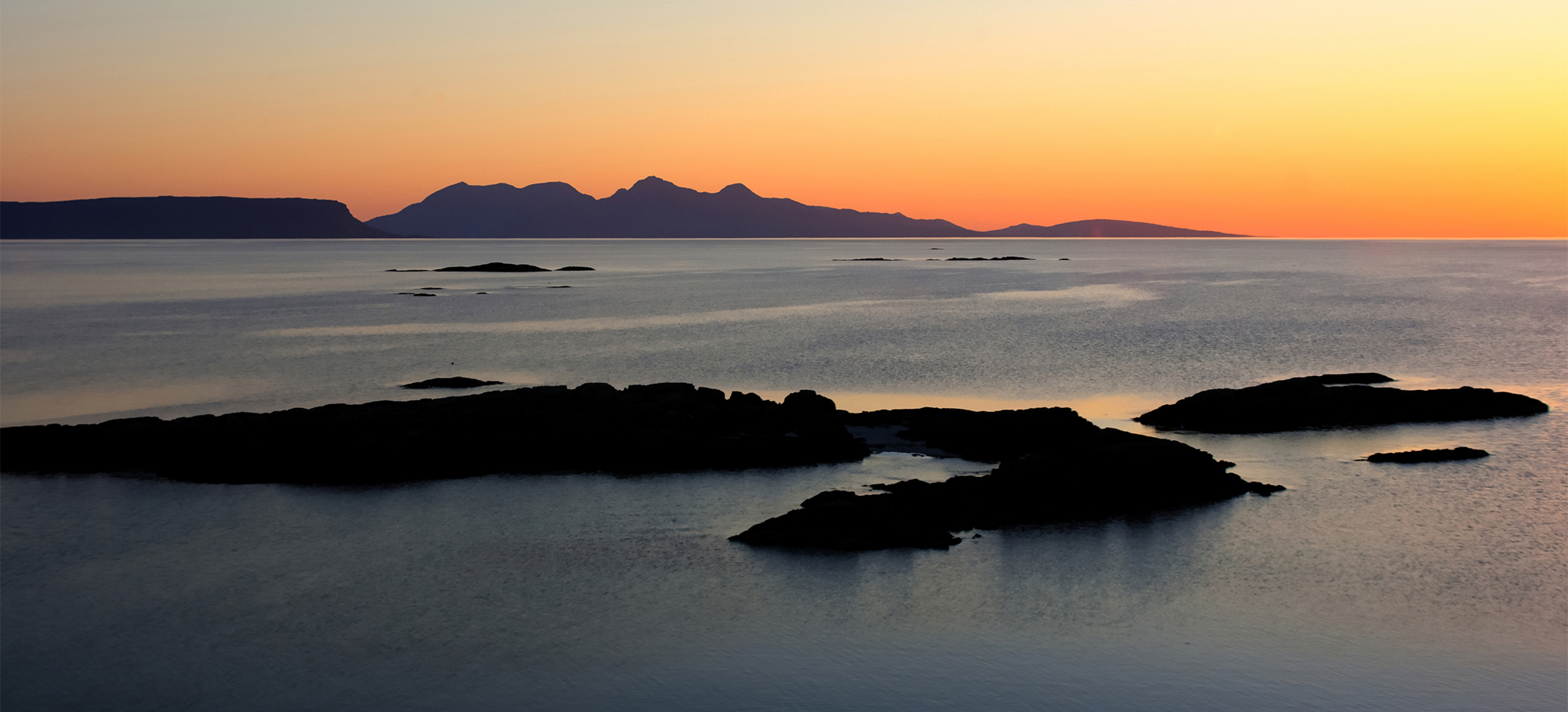 Sunset over the Scottish Islands of Rum and Eigg